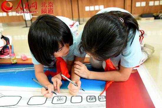 """东城崇外街道""""我爱你中十丈软红歌词国""""主题教训运动走进新景小学"""